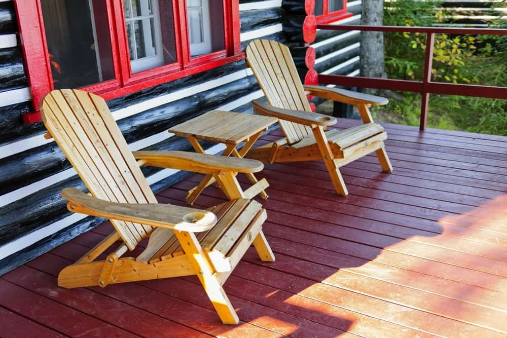 Two chairs on the deck of a cabin
