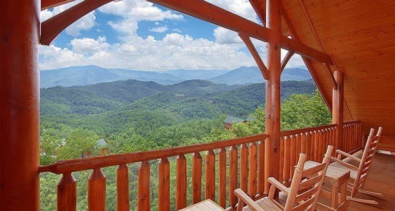 The deck with mountain views at Heavenly Heights Retreat, one of our Smoky Mountain resort cabins.