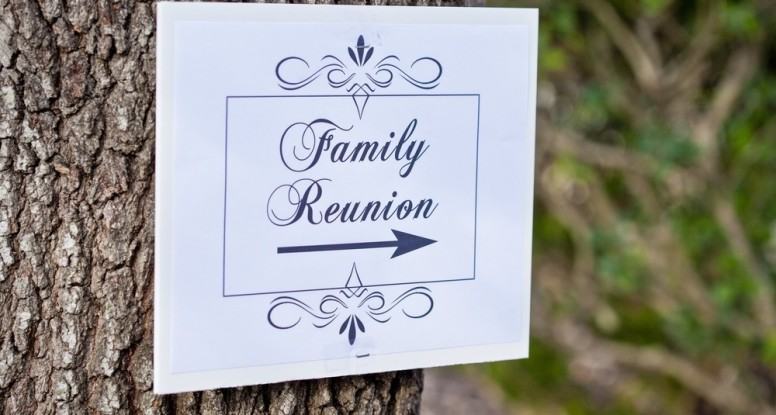 A sign on a tree pointing to a family reunion at our Smoky Mountain cabin resort.
