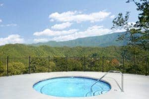 The outdoor hot tub with mountain views at The Preserve Resort in Wears Valley TN.