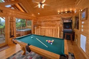 Game room with pool table and arcade game in Wears Valley cabin