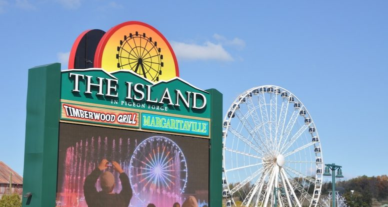 The Island sign with the Wheel in the background